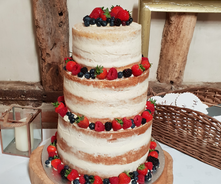 3 tier vanilla naked cake with berries